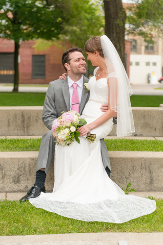 Just married sitting in Catalano Square in Milwaukee WI