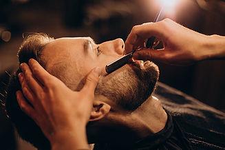 handsome-man-shaving-beard-barbershop.jp