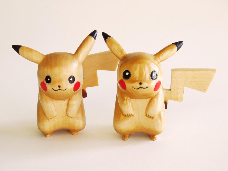 Two Pikachu Wood Carvings