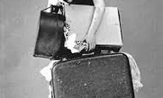 Woman carrying a lot of old baggage