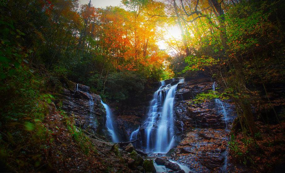 a-beautiful-waterfall-in-the-forest-with-autumn-leaves_HXXEkfl0 (1).jpg
