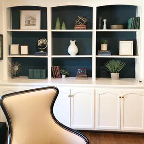 Dark bookshelves styled