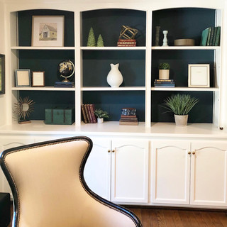Dark bookshelves styled