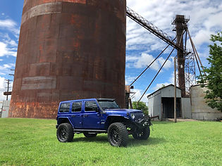 Blue_Lifted_Jeep_JL_Xclusive_Truck_Kusto