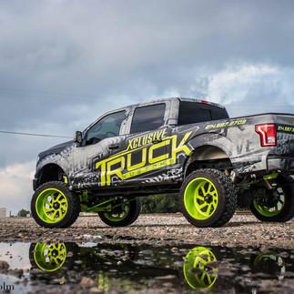 Shop_Truck_New_Wrap_Lifted_F150_FTS_Xclu
