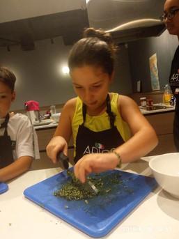 Kids learn Italian dishes