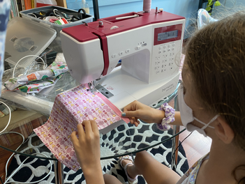Kids learn sewing in Singapore