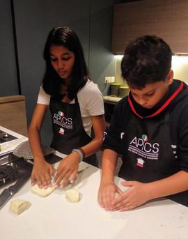 Kids making Italian pizza