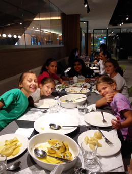 Kids enjoying their cooked meal