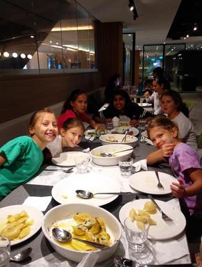Kids enjoying their cooked meal