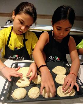 Kids cooking camp teamwork