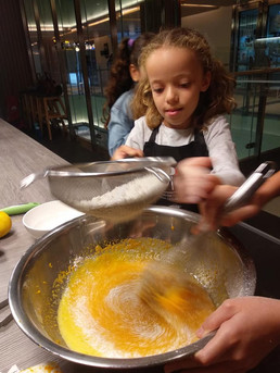 Kids team work in cooking camp