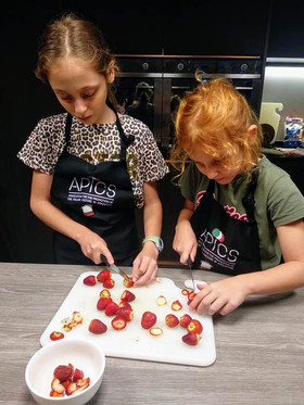 Kids working together cooking camp