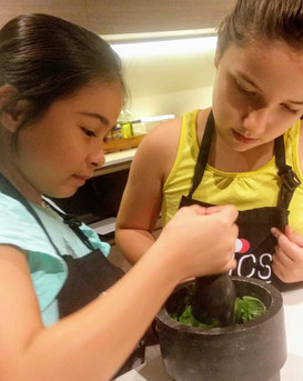 Kids making fresh pesto
