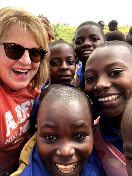 Jana with a group of kids