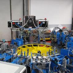 Impianto transfert di lavorazione testine caloriferi