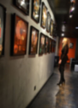 Robin Cisek looking at platinum records in the recording studio