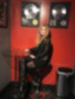 Robin Cisek posing in front of beyonce's lemonade album