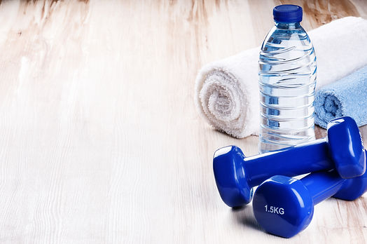 Fitness concept with dumbbells and water