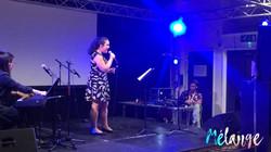 Singing at the Melange fundraiser