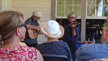 Neil and Judy perform in a concert at Vailima, Samoa, the house built by RL Stevenson and his wife Fanny, now a museum.