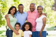 extended-family-standing-in-park-smiling