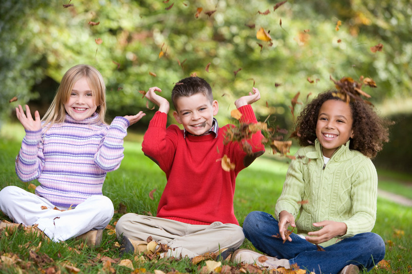group-of-children-playing-in-autumn-leav