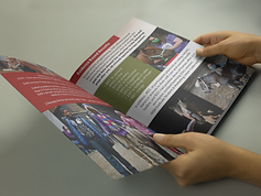 mockup-of-a-catalog-held-by-a-girl-on-a-gray-surface-while-looking-at-it-a14597.png