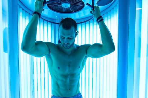 Young Muscular Man At Solarium In Beauty Salon.jpg