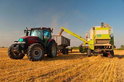 Modern combine harvester unloading grain