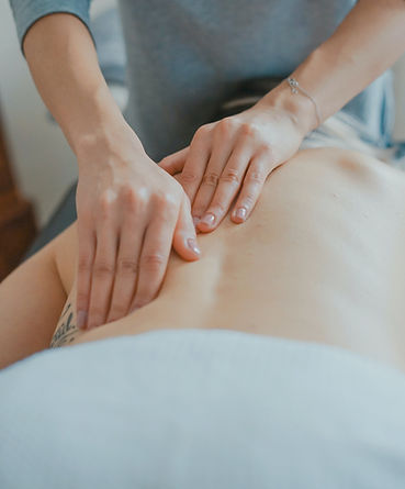 Close-up of hands giving a lower back massage