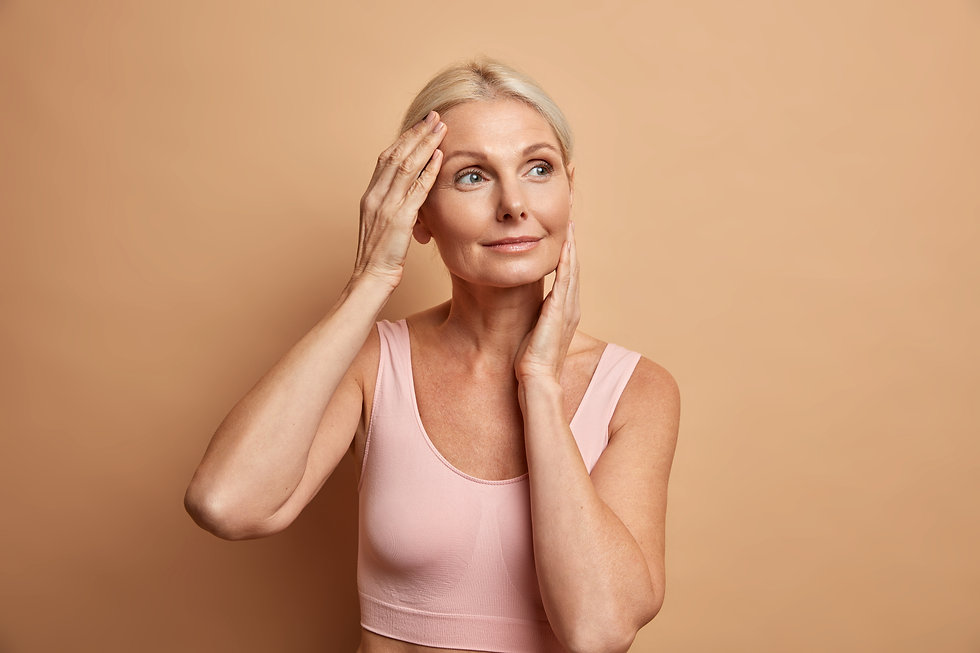 portrait-mature-elderly-european-woman-touches-face-gently-has-perfect-skin-looks-thoughtf