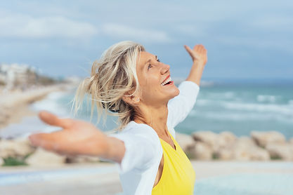 Joyful woman enjoying the freedom of the