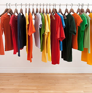 Colorful clothing on hangers