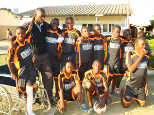 Nugent's 'Wear your Footy Shirt to Work Day' provides a footy kit for school in Zambia