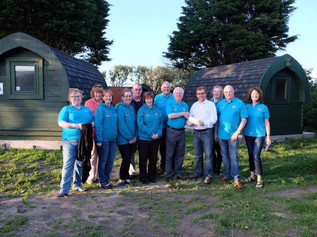 Formby Squirrels Rotary present a cheque  for the Altcar Pods project