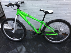 A green Mountain Bike has been found with Shock stickers and Scorpion motif