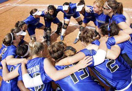team huddle in blue.jpg