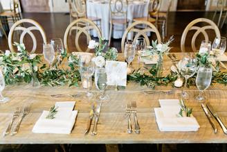 Emma Lea Floral- Purple Summer Events- Callie Hobbs Photography- Devils Thumb Ranch Colorado Wedding | Loose Greenery Runner | Bud Vases | White Flowers | Navy Berries |