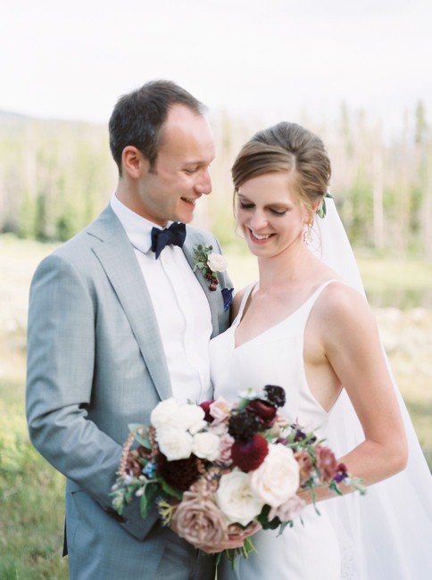 Emma Lea Floral- The Styled Soiree- Sara Lynn Photography- Devils Thumb Ranch Colorado Wedding | Bouquet Inspiration | Burgundy, Blush, Ivory, Blue | Garden Rose | Dahlia | Sweetpea | Andromeda | Bride & Groom | Mountain Wedding |