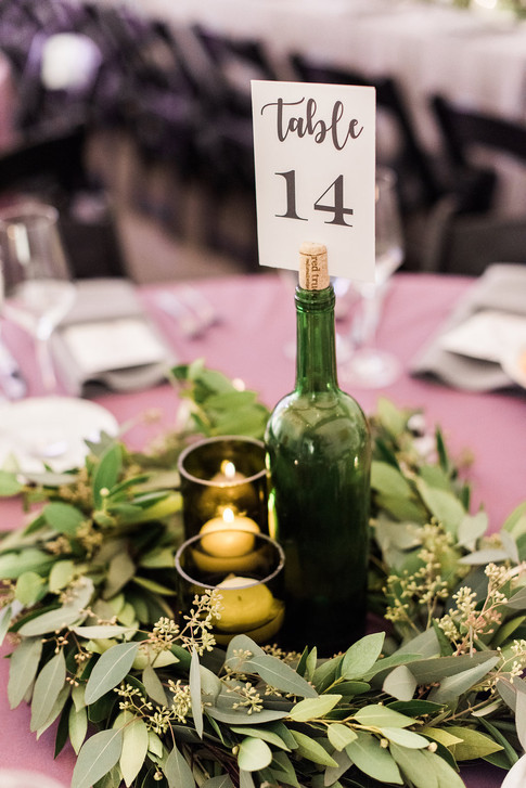 Emma Lea Floral - Purple Summer Events- Kristen Pierson Photography- Space Gallery Denver Colorado Wedding | Wine Bottle Table Number | Greenery Wreath | Wine Themed Wedding | Eucalyptus |