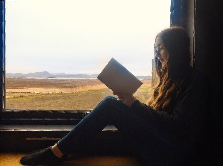 Reading a book in Iceland