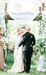 Emma Lea Floral- The Styled Soiree- Maribeth Photography- Buena Vista Colorado Wedding | Ceremony Arch | Chiffon | Greenery | Aspen Grove | Bride & Groom | Kiss |