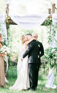 Emma Lea Floral- The Styled Soiree- Maribeth Photography- Buena Vista Colorado Wedding | Ceremony Arch | Chiffon | Greenery | Aspen Grove | Bride & Groom | Kiss |
