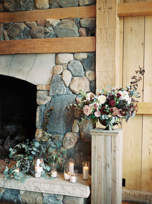 Emma Lea Floral- The Styled Soiree- Sara Lynn Photography- Devils Thumb Ranch Colorado Wedding  | Fireplace Floral Arrangement and Candles | Burgundy, Blush, Ivory | Mountain Wedding |