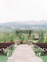 Emma Lea Floral- Purple Summer Events- Callie Hobbs Photography- Devils Thumb Ranch Colorado Wedding | Potted Herbs | Lavender | Olive | Aisle Arrangements | Ceremony Flowers | Pergola | Greenery | White Flowers |