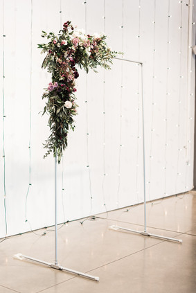 Emma Lea Floral - Purple Summer Events- Kristen Pierson Photography- Space Gallery Denver Colorado Wedding | Ceremony Flowers | Modern Copper Arch | Purple, Lavender, Mauve, Burgundy | Rose | Ranunculus | Bay | Olive |