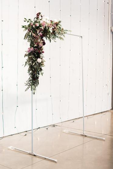 Emma Lea Floral - Purple Summer Events- Kristen Pierson Photography- Space Gallery Denver Colorado Wedding | Ceremony Flowers | Modern Copper Arch | Purple, Lavender, Mauve, Burgundy | Rose | Ranunculus | Bay | Olive |