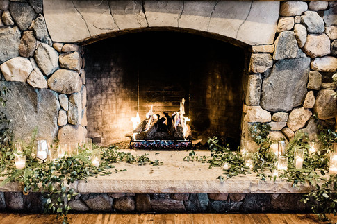 Emma Lea Floral- Purple Summer Events- Kristen Pierson Photography- Devils Thumb Ranch Colorado Wedding   Stone Fireplace   Greenery With Candles In Glass  