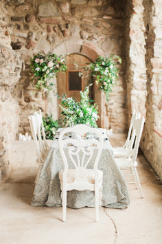 Emma Lea Floral- The Styled Soiree- Sara Lynn Photography- Cherokee Ranch And Castle Wedding | Denver Colorado Fine Art Floral Design - Wedding and Event Florist | Centerpiece | Spirea | Clematis | Garden Rose | Jasmine | Garden Style | Greenery | White | Backdrop | Arch |